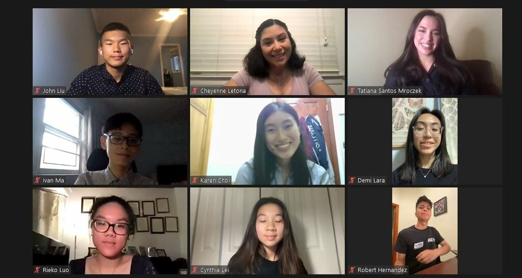 Screenshot from virtual meeting with 9 students smiling in group photo. 3 masculine presenting students and 6 feminine presenting students. Diverse cultures and styles.