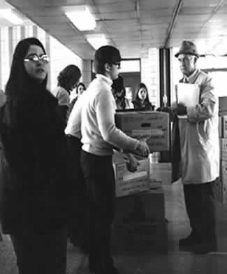 Students and volunteers work on packaging grinders to deliver during Super Bowl Weekend in 1971 as a CSF fundraiser